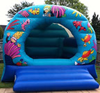 Underwater themed bouncy castle for children. Great for birthday party. Fun and safe inflatble available for hir in basingstoke, hampshire